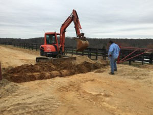VEA Track Superintendent John Dale Thomas oversees prep work to install drainage tiles at Eagle Point Farm