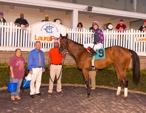 7 year old Rose Brier in the winner's circle after the Henry Clark Stakes. Photo by Jim McCue.