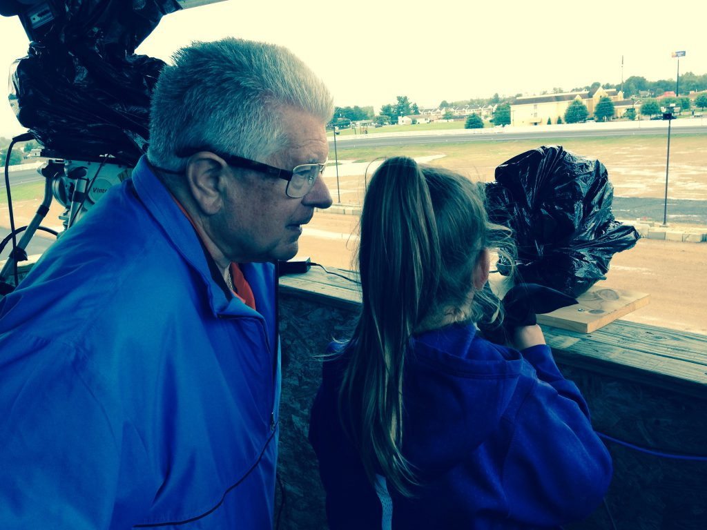 Roger Houston gives pointers to 8-year-old Morgan Marston as she calls a qualifying race at Shenandoah Downs last weekend.