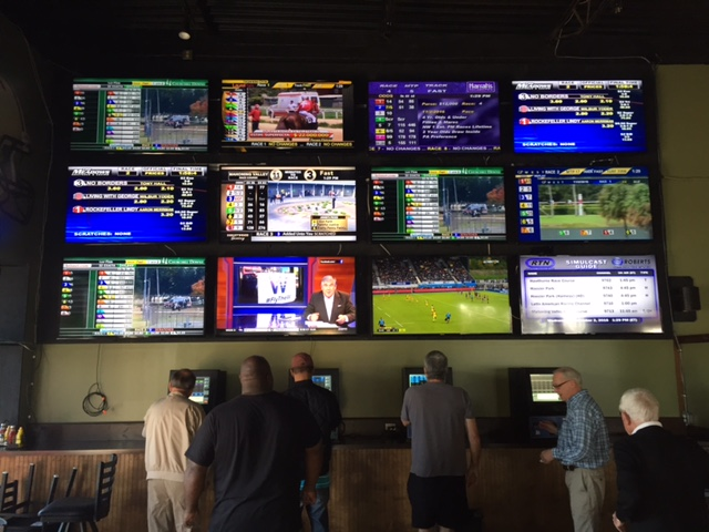 The horse racing video wall at Breakers has become quite popular with players.