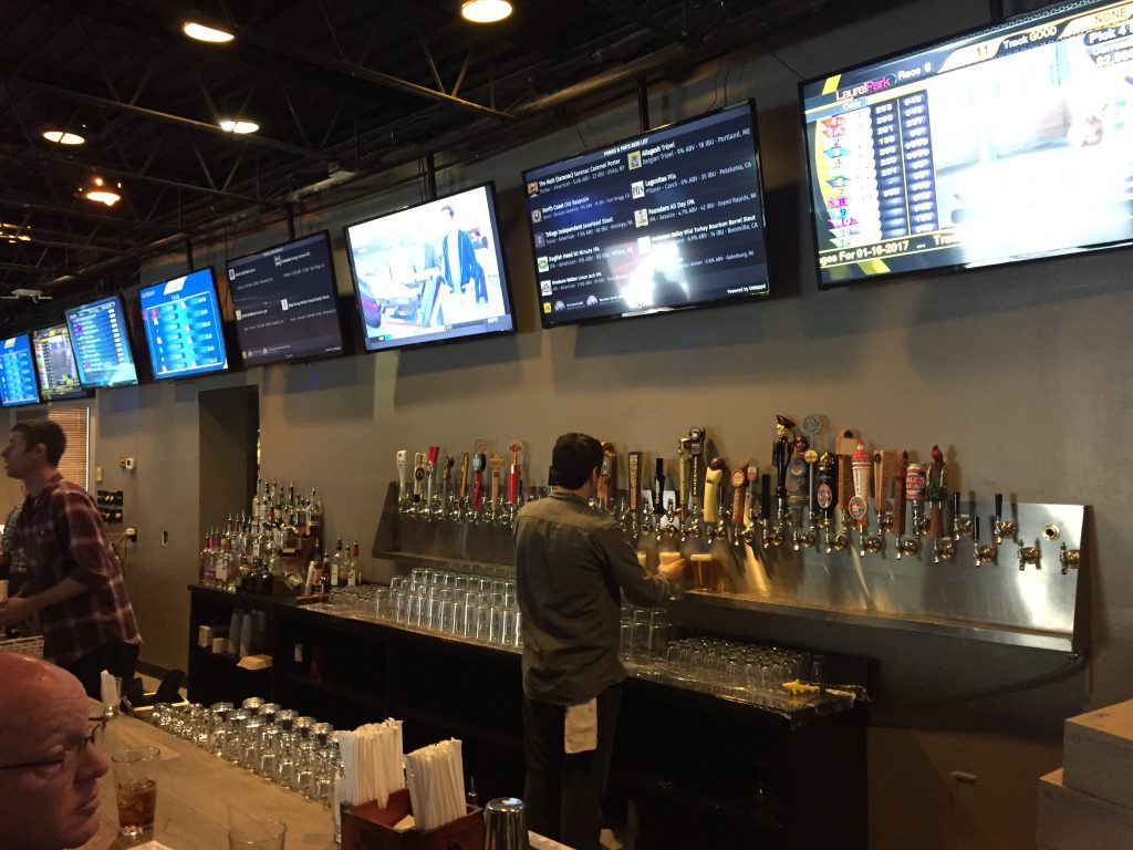 Ponies & Pints features over 50 beers on tap and 35 flat screen TVs to show horse racing action from around the country.
